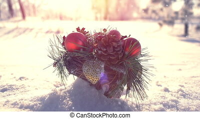Christmas decoration on snow drift slowmotion