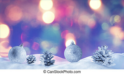 christmas decoration on snow drift with bokeh light on...