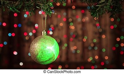 Christmas decoration on the tree with a silver ball with laser beams.
