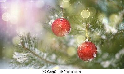 Christmas decoration on tree and fairy snowfall seamless loop