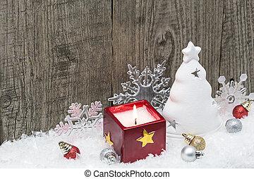Christmas decoration on weathered wood background