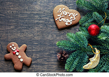Christmas decoration over dark wooden background, top view. Horizontal photo of decorations taken from above with copy space for text