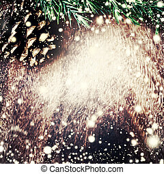 Christmas decoration over grunge background - Christmas fir tree on dark wooden board with Falling Snow. Card or invitation.