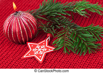 Christmas decoration over red wool fabric background