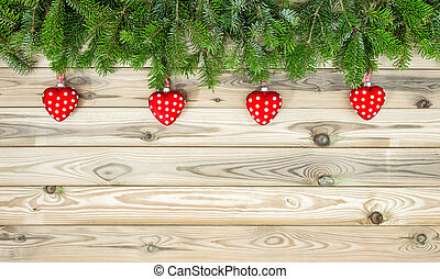 Christmas decoration red heart ornaments pine branches