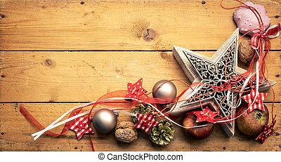Christmas decoration red ribbon on a star with wooden background