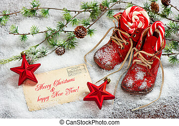 Christmas decoration red stars and antique baby shoes