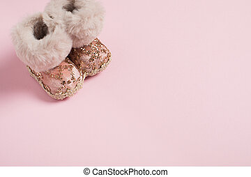 Christmas decoration shoes on a pink background
