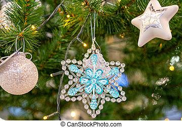 Christmas decoration stars and balls on the Christmas tree close-up