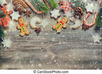 Christmas decoration with gingerbread cookies,fir branches...