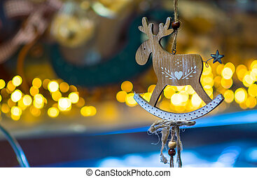 Christmas decoration with a wooden deer hanging on a thread