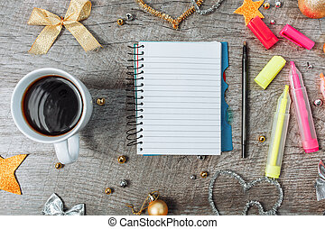 Christmas decoration with an open notebook and a cup of coffee, planning the new year.