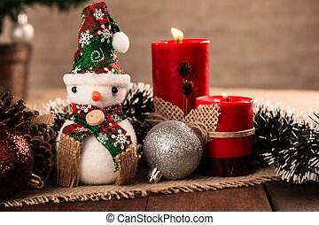 Christmas decoration with balls and candle