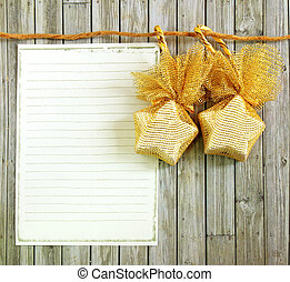 Christmas decoration with blank notebook over wooden background