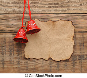 Christmas decoration with blank old paper on the wooden wall