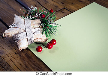Christmas decoration with blank paper on wooden table