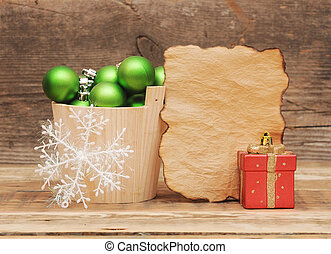 Christmas decoration with blank vintage paper on wooden table