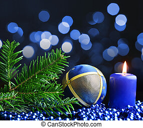 Christmas decoration with burning candle and fir branch.