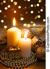Christmas ornaments over dark golden background with lights.