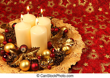 Christmas decoration with four candles on red Christmas background. Shallow DOF, copy space