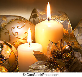 Christmas decoration with candles over dark background