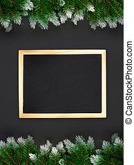 Christmas decoration with fir branches on a dark background with copy space and center frame ived chalk board. Banner mockup, postcard. Flat lay, top view, overhead.