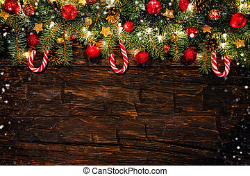 Christmas decoration with fir branches on wooden planks