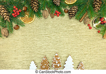 christmas decoration with fir-tree branches, spices and homemade gingerbread cookies