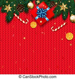 Christmas decoration with fir tree, gift, candy canes on red kni