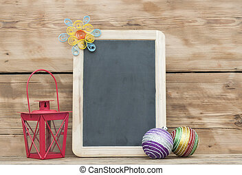 Christmas decoration with framed blackboard on wooden background