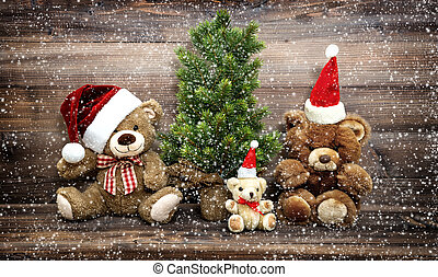 Christmas decoration with funny toys Teddy Bear family in snow