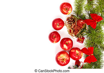decoration with green pine or fir and many scattered red apples