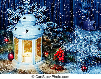 Christmas decoration with lantern in snowstorm