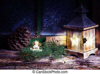 Christmas decoration with lantern in the window