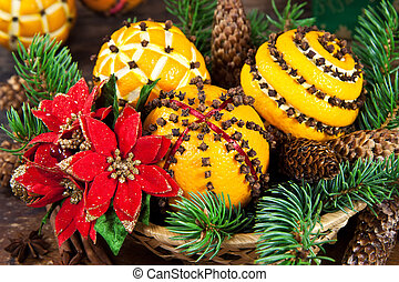 Christmas decoration with oranges and fir tree