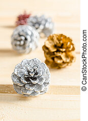 Christmas, decoration with pine cones silver.