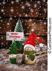 christmas decoration with snow on wooden background -...
