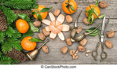 Christmas decoration with tangerine fruits and walnuts on...