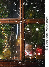 Christmas decoration with teddy bear in window