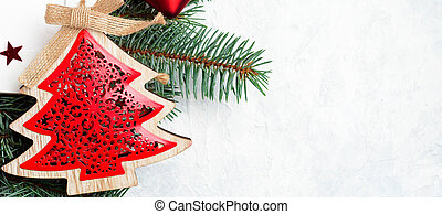 Christmas decorations and branches of a New Year tree on abstract background. Flat lay, top view, copy space