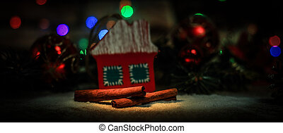 Christmas decorations and cinnamon sticks on a festive backgroun