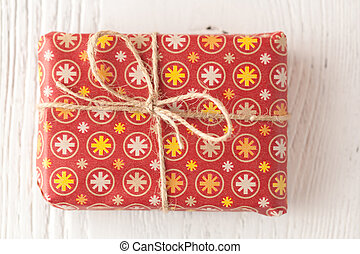 Christmas decorations and gift boxes on wooden background