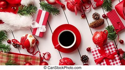 Christmas decorations and presents around coffee - From...