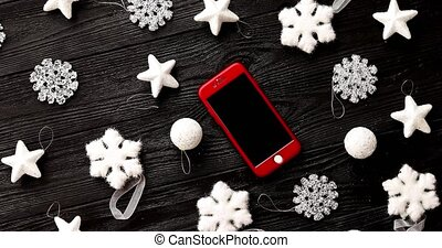 Christmas decorations and smartphone - From above view of...