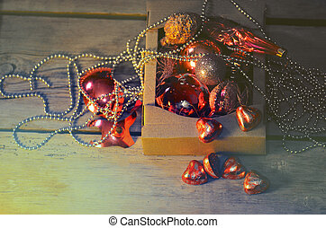 Christmas decorations and toys in a cardboard box