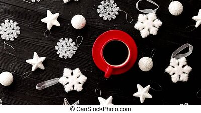 Christmas decorations around hot beverage - From above shot...