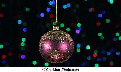 Christmas decorations, ball hanging on the background of flashing lights.