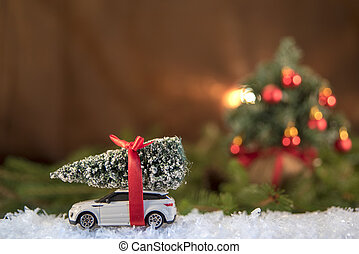 Christmas decorations. Christmas tree over toy car