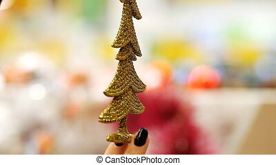Christmas decorations, close-up, in the hand