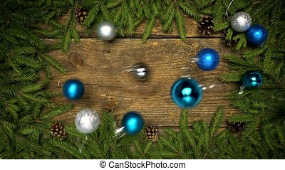 Christmas decorations falling on a wooden background with...